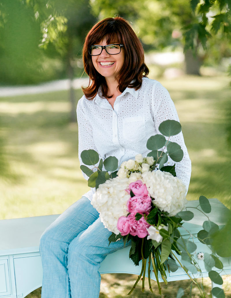 Kathy Sitting with Flowers